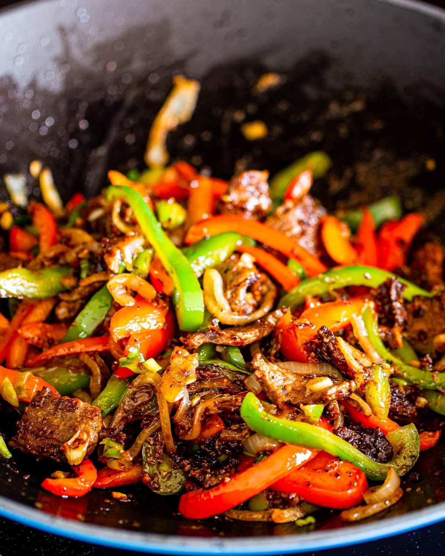 asian style pepper steak in a wok.