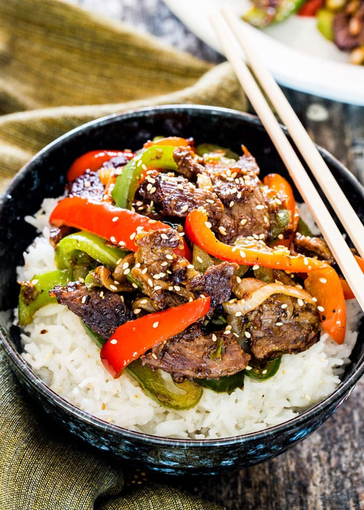 Asian Style Pepper Steak over rice served in a bowl