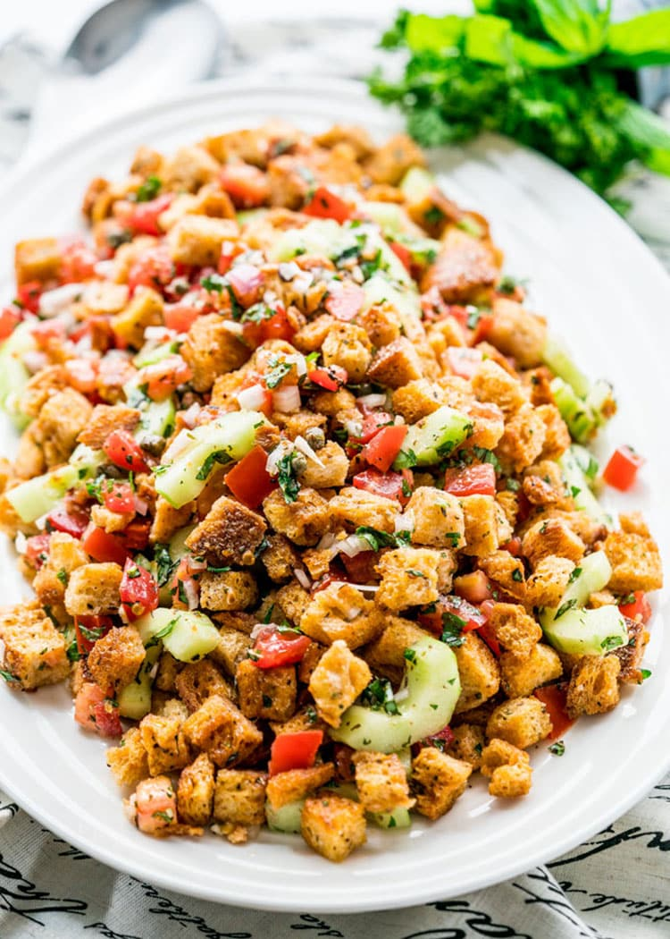 panzanella salad on a white platter