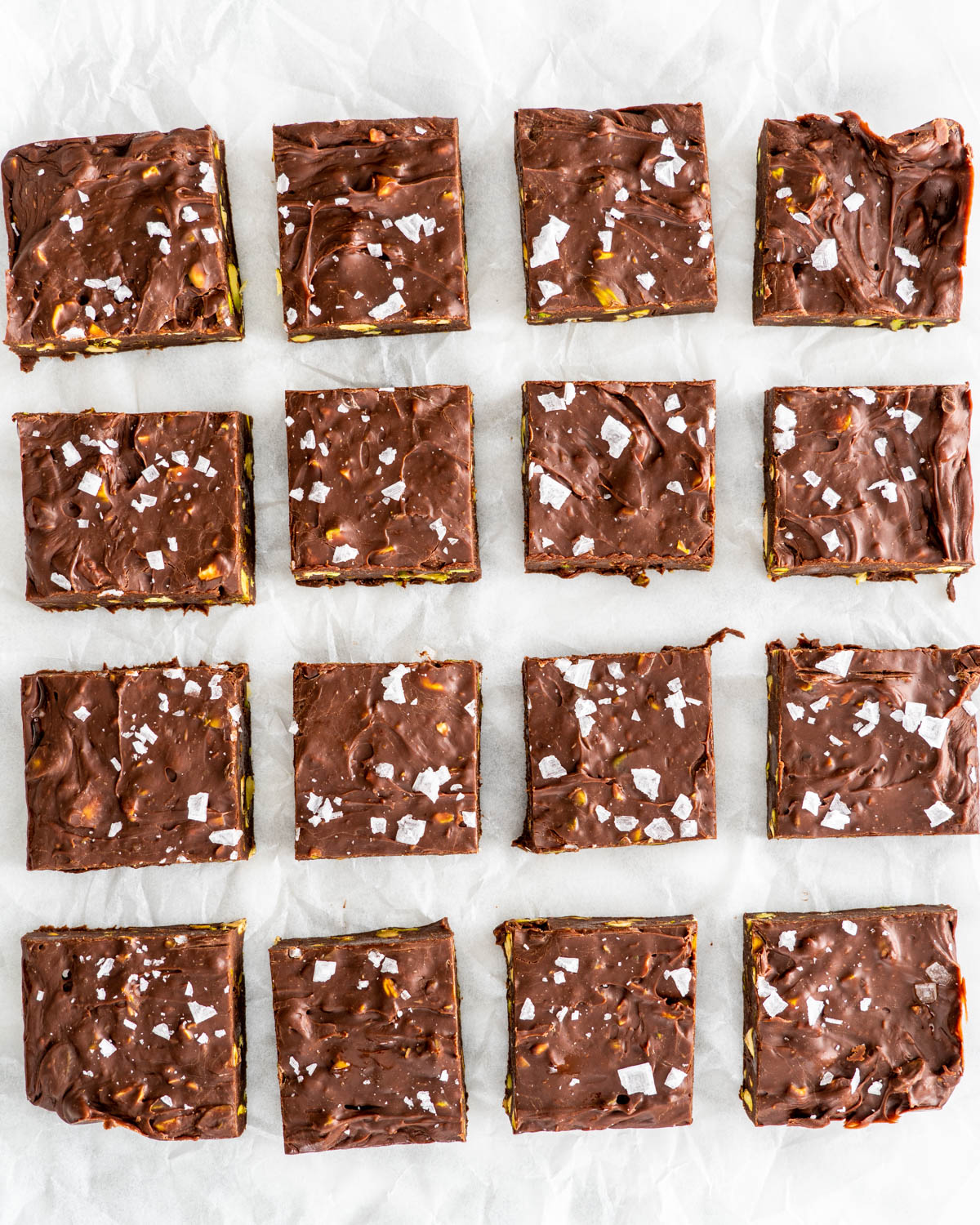 chocolate fudge on parchment paper cut into squares