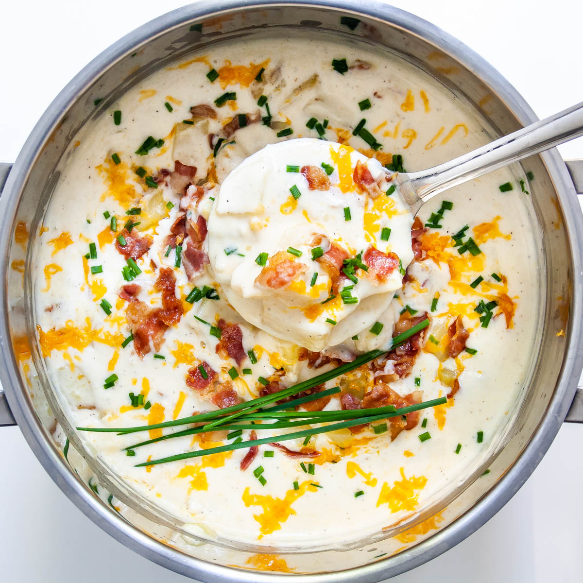 overhead shot of baked potato soup in a pot