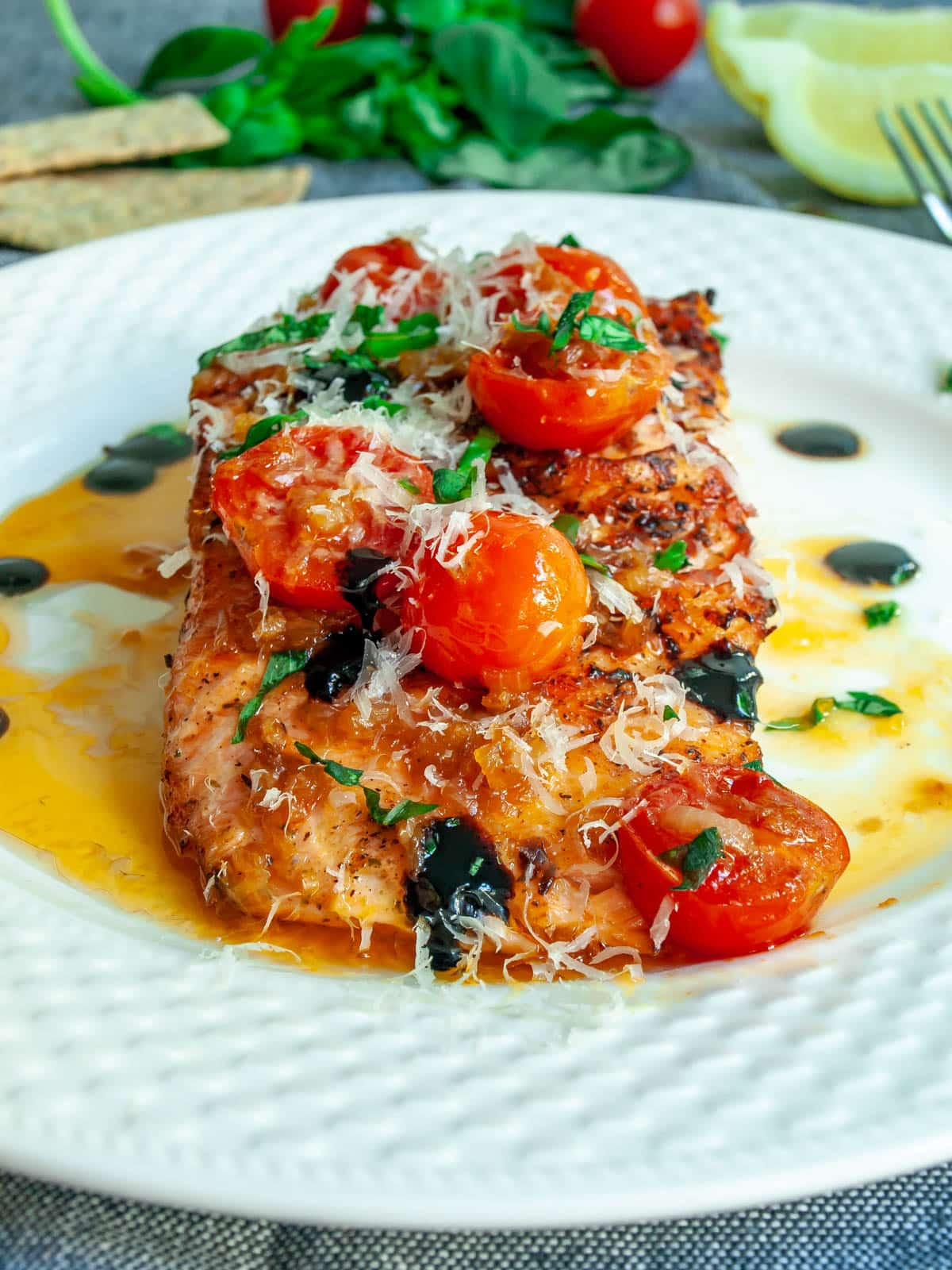 bruschetta salmon fillet on a white plate