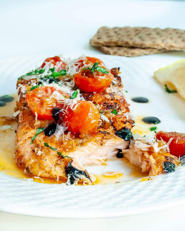a bruschetta salmon on a white plate