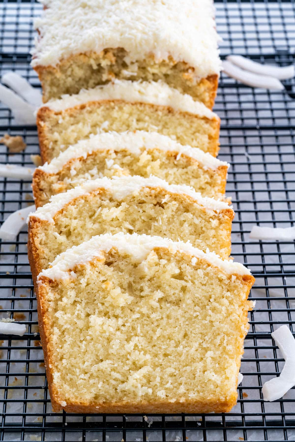 slices of coconut cake on a cooling rack