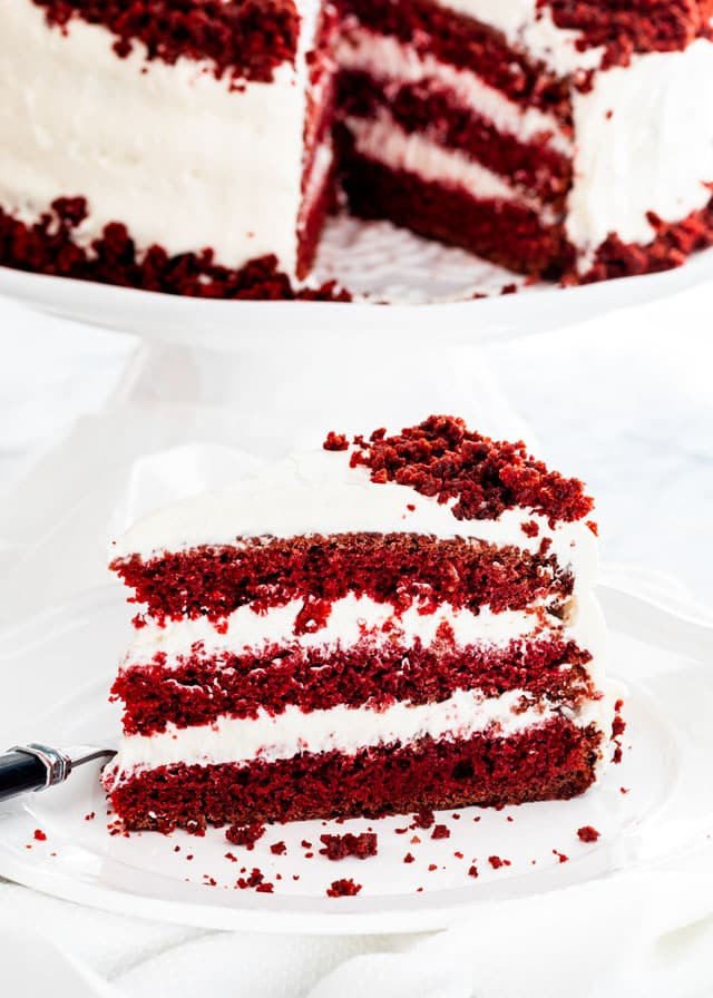 a slice of red velvet cake on a white plate