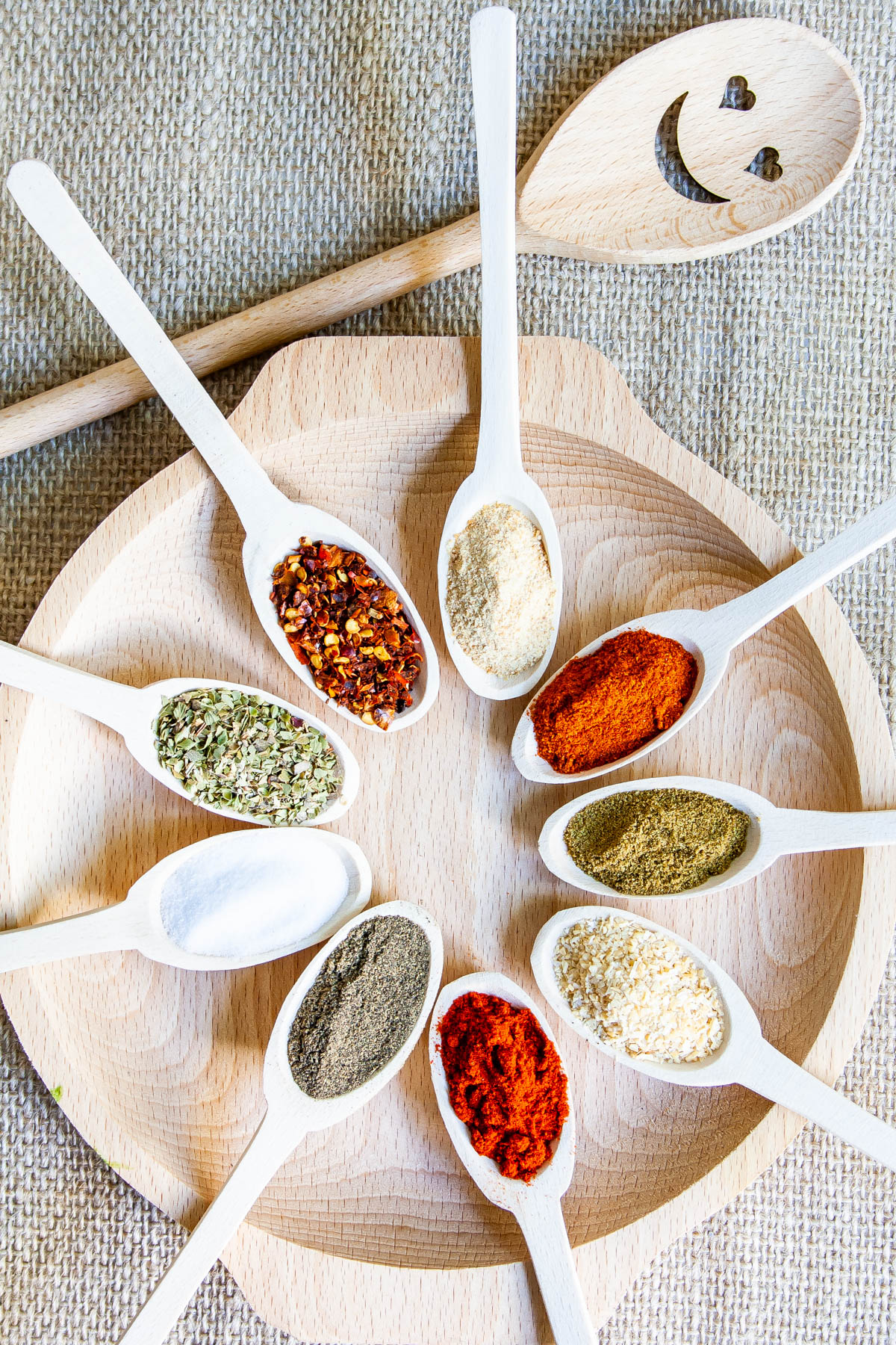 a spoon with each spice needed to make taco seasoning