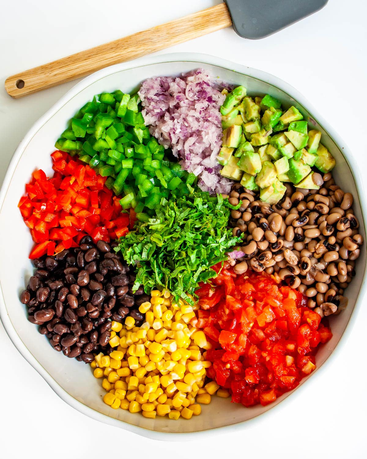 all ingredients in a bowl needed to make Cowboy Caviar