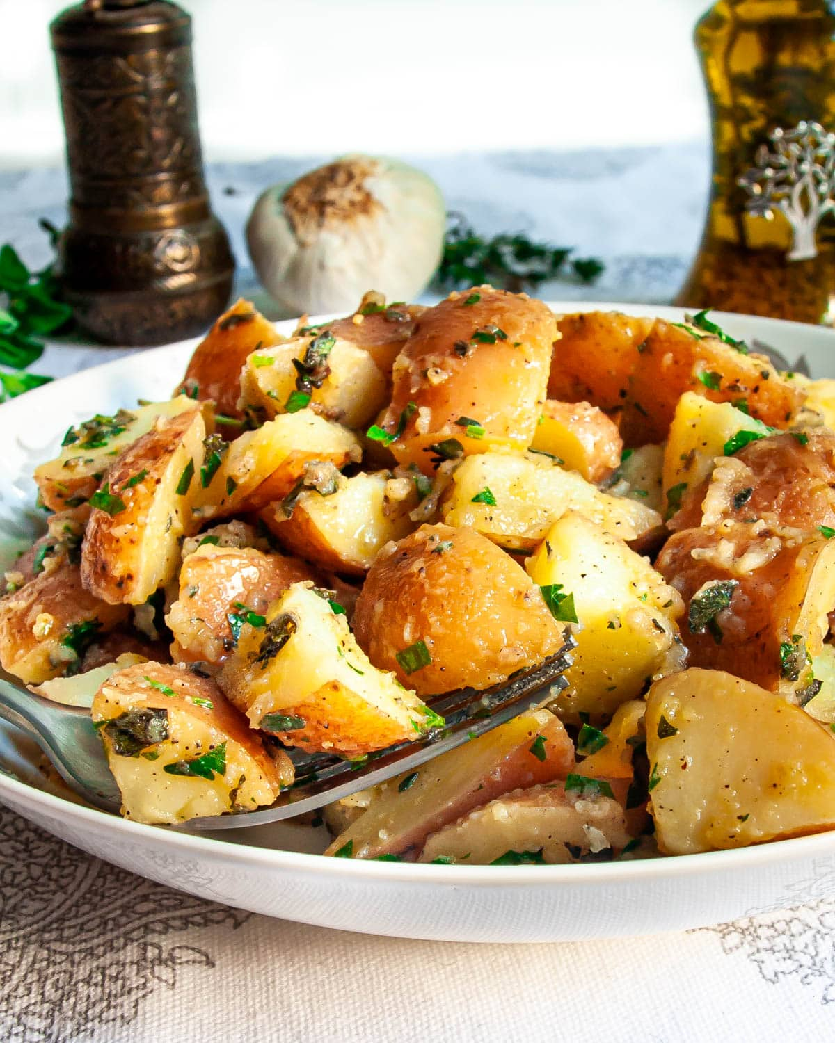 Garlic Herb Red Potato Salad in a white bowl