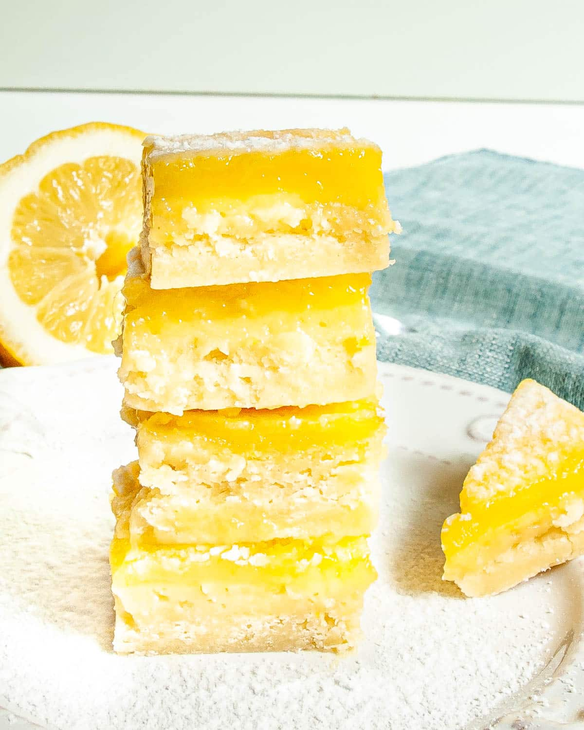 a stack of lemon bars on a white plate