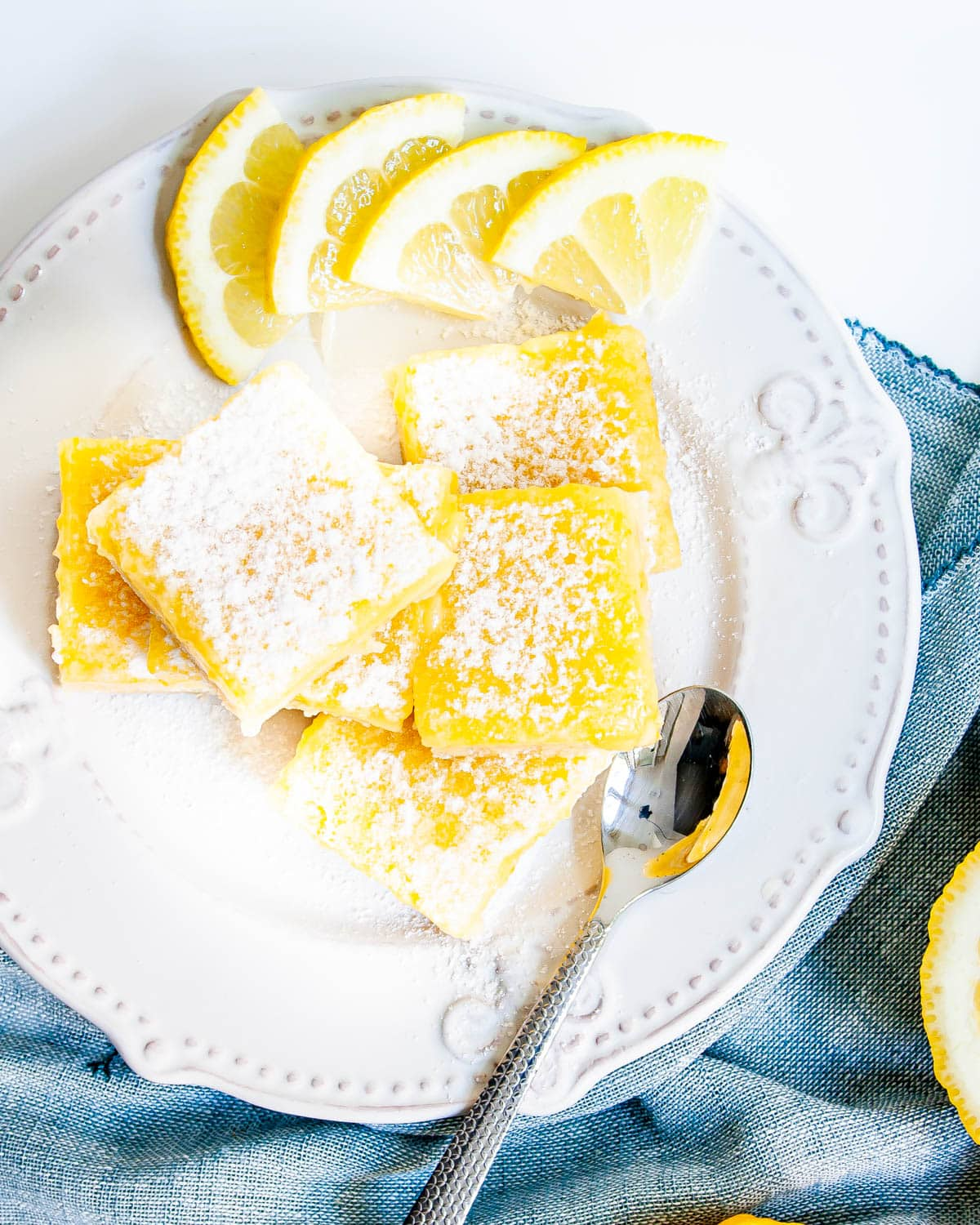 overhead shot of lemon bars on a white plate