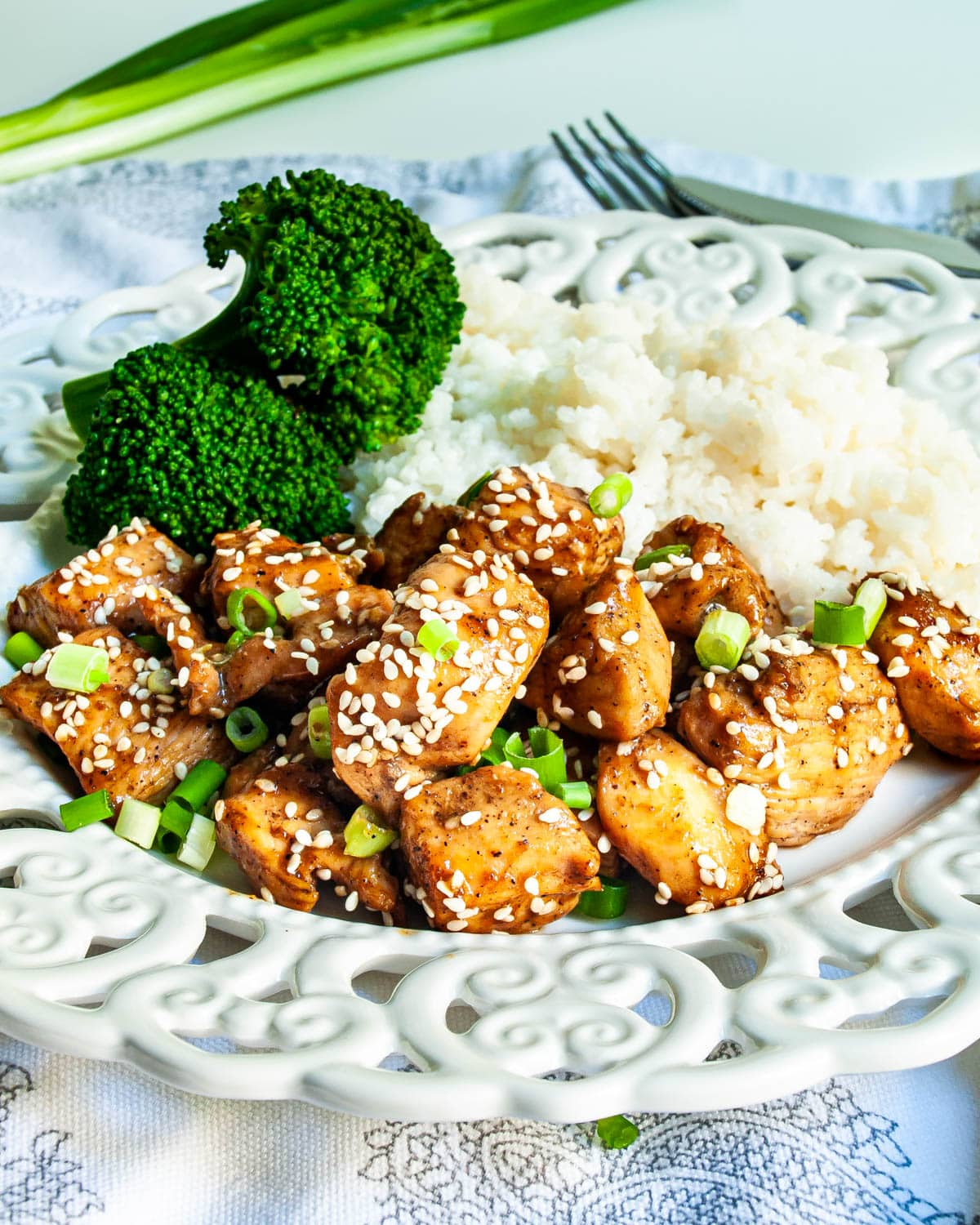 chicken teriyaki with rice and broccoli on a white plate