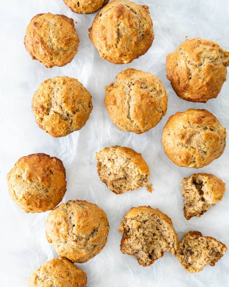 overhead shot of a bunch of muffins on parchment paper