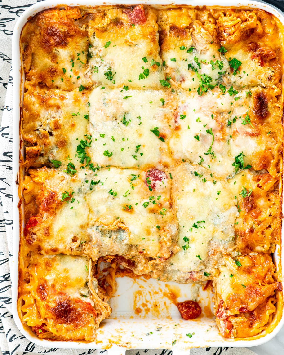 overhead shot of Buffalo Chicken Lasagna in a white casserole dish
