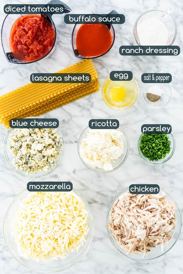 overhead shot of all ingredients needed to make Buffalo Chicken Lasagna