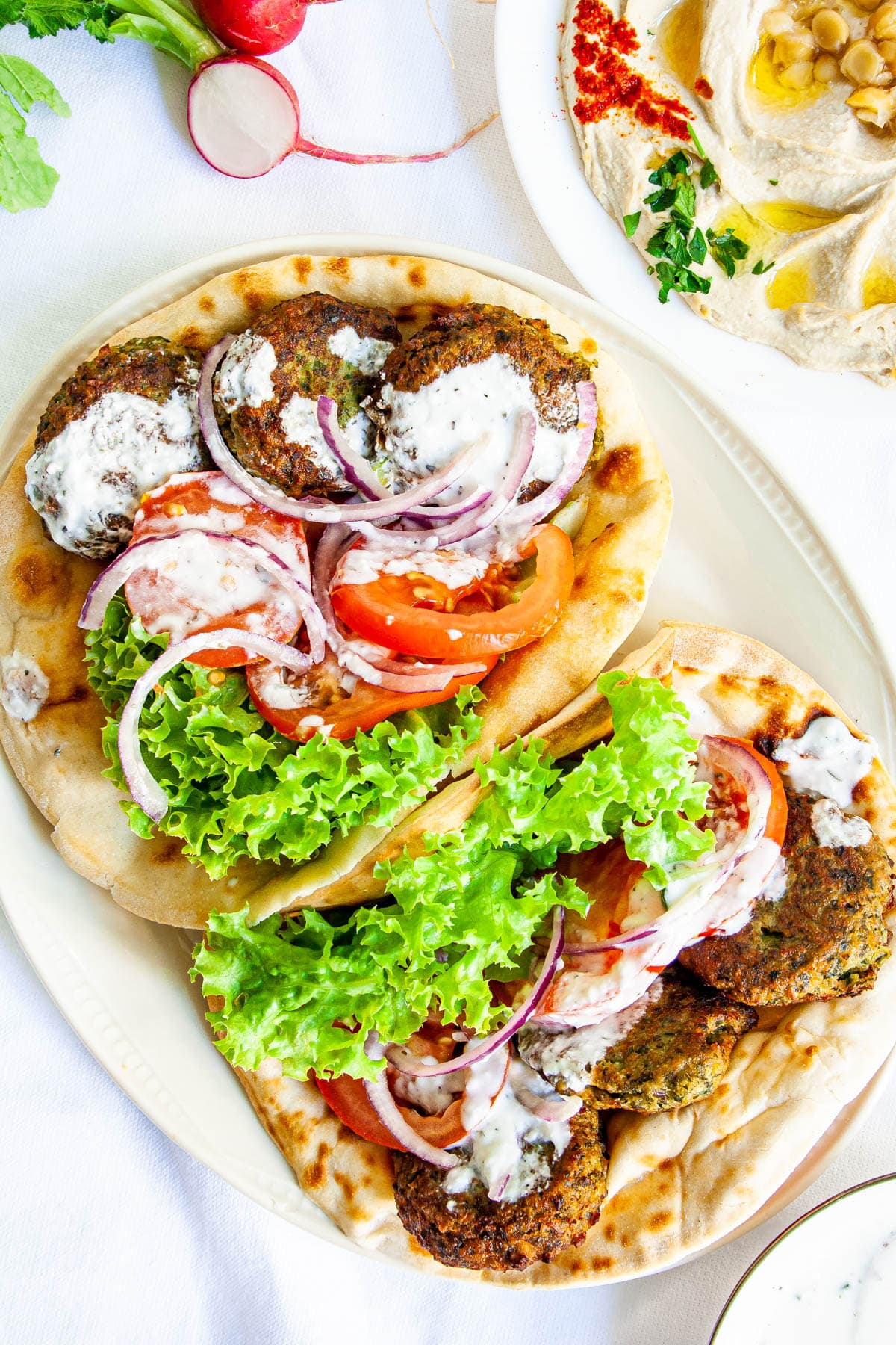 falafel in pita breads with tomatoes, onions, lettuce and tzatziki