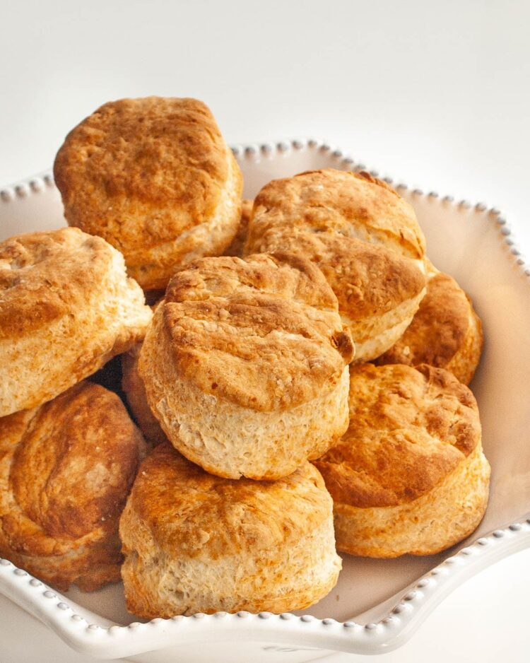 parmesan buttermilk biscuits in a white bowl