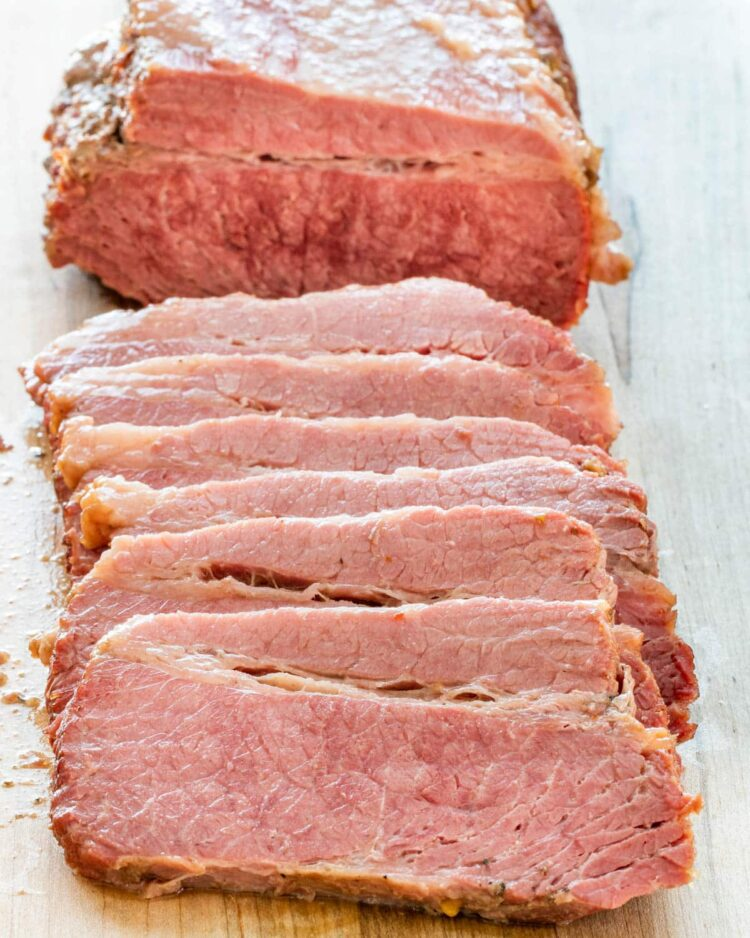 corned beef sliced up on a cutting board