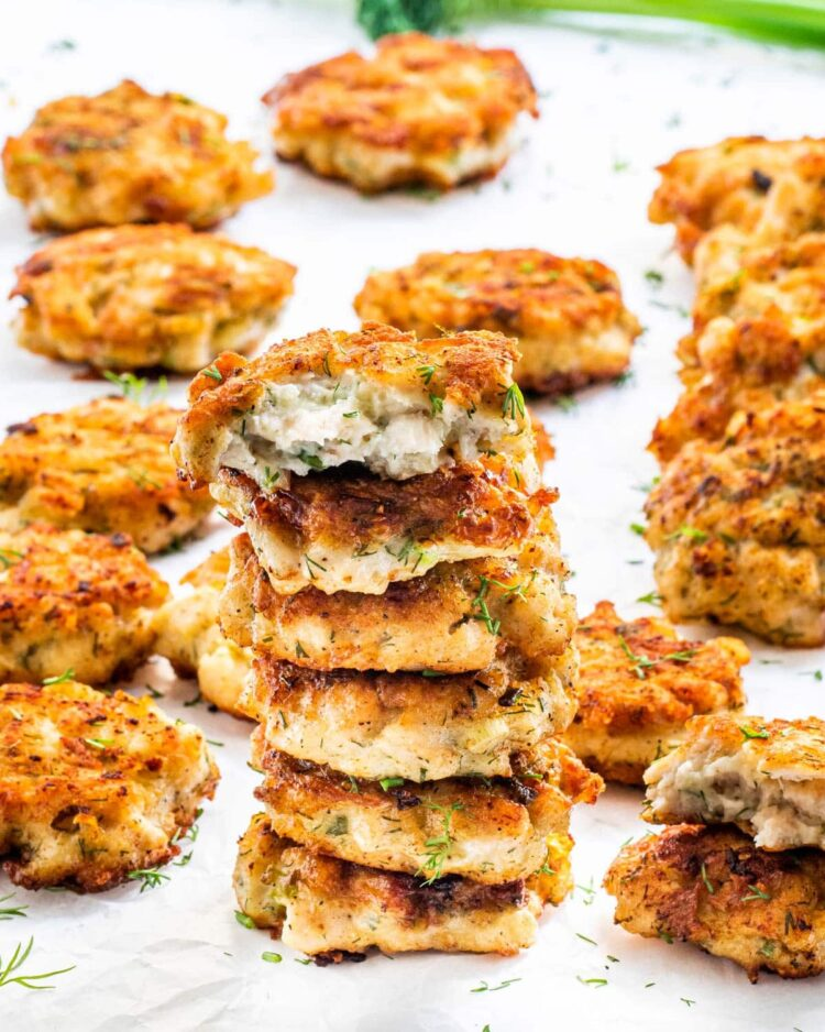 a stack of chicken fritters on parchment paper