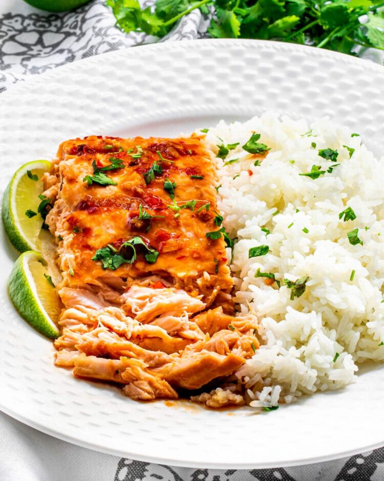 flaked thai salmon next to rice on a white plate