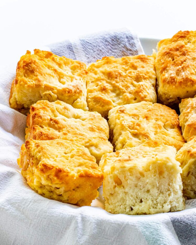 a bunch of fresh butter biscuits in a basket