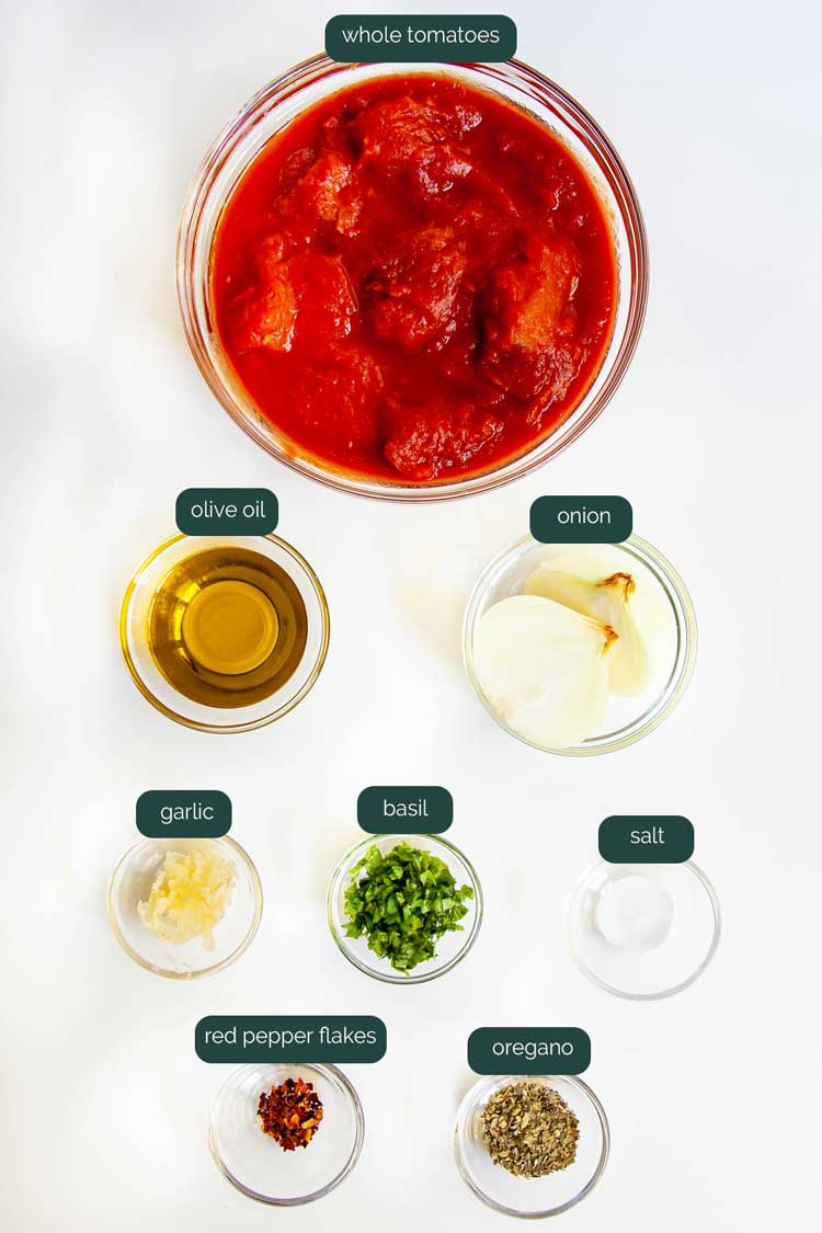 overhead shot of all the ingredients needed to make marinara sauce