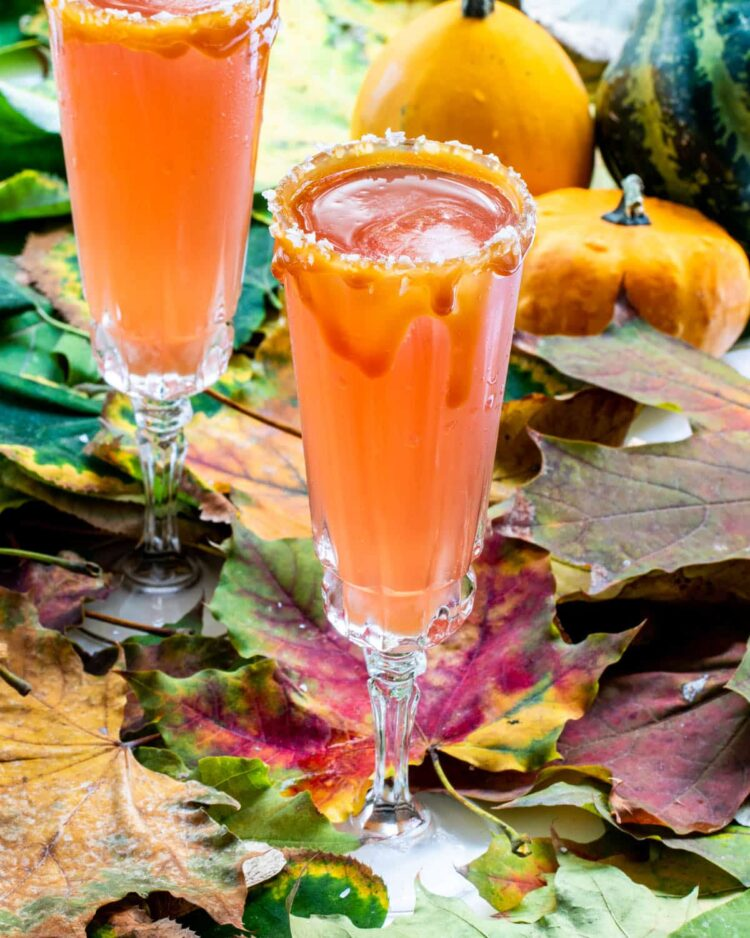 two flutes with Pomegranate Cider Mimosas