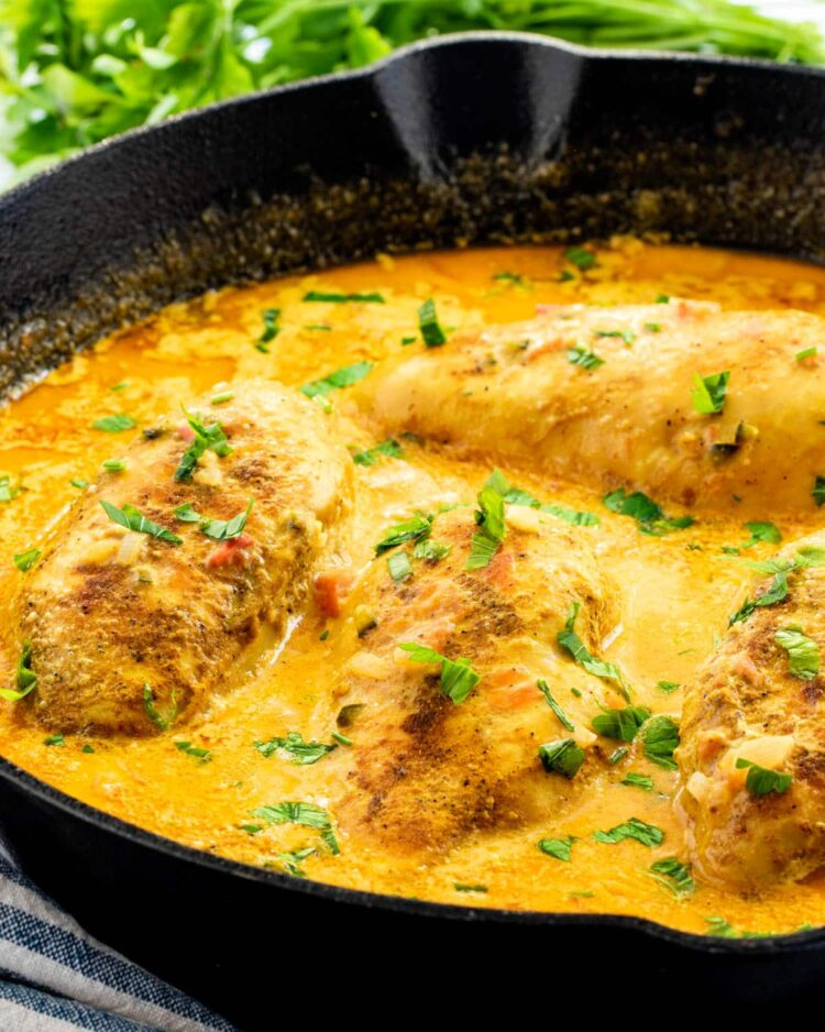 brazilian coconut chicken in a black skillet