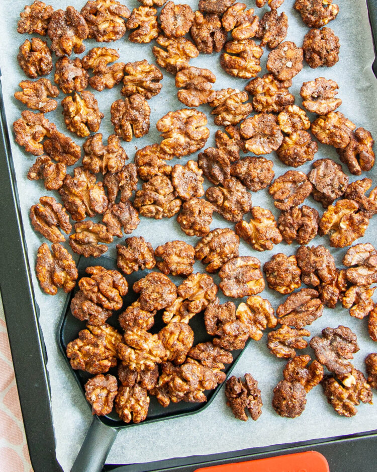 overhead shot of candied walnuts on a baking sheet