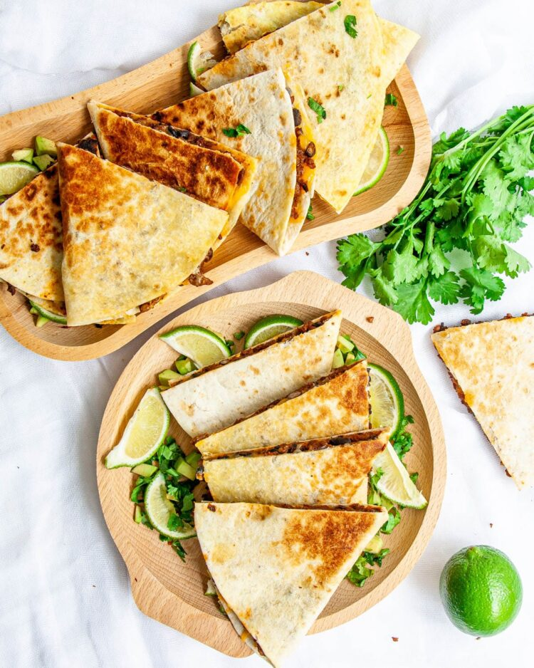 overhead shot of beef quesadillas on wooden plates