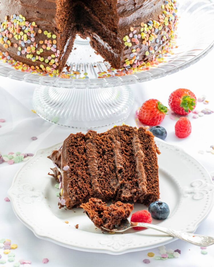 a slice of chocolate cake with a bite taken out of it