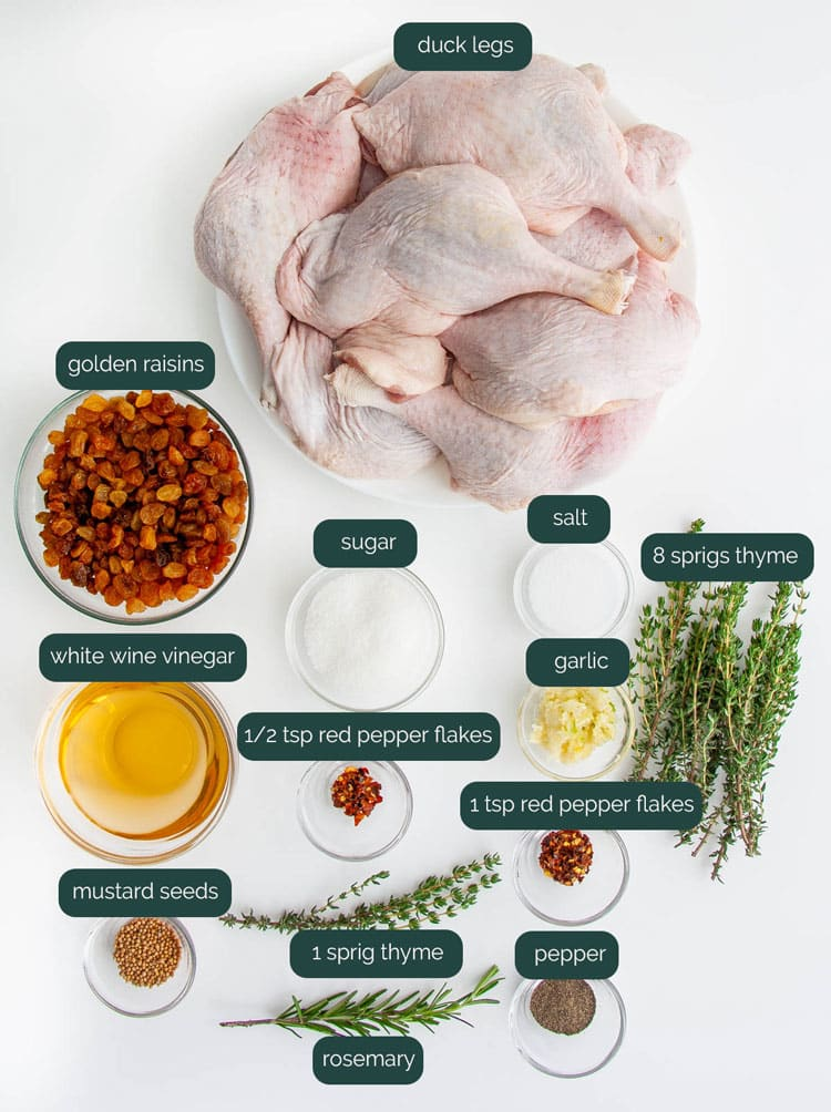 overhead shot of ingredients needed to make duck confit with pickled raisins