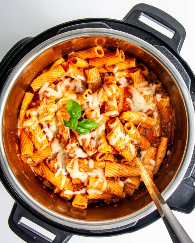 baked ziti in an instant pot garnished with some fresh basil