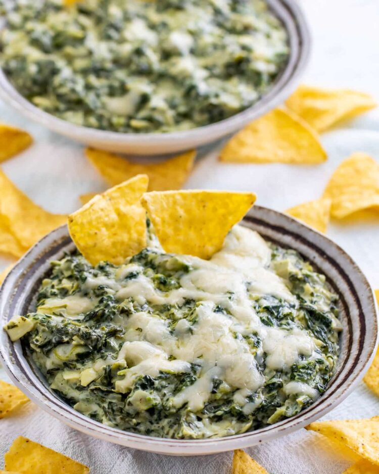 spinach dip in a bowl with tortilla chips