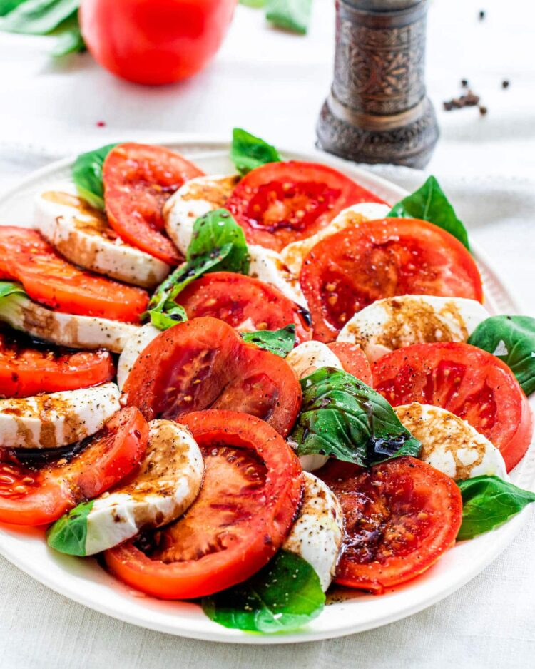caprese salad on a white platter