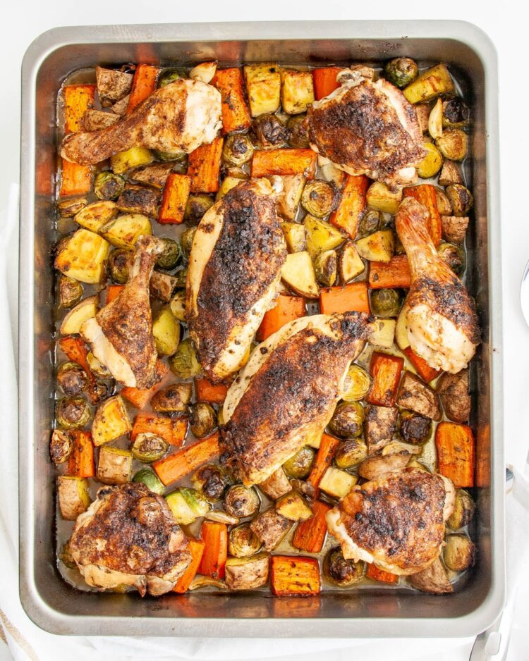 overhead shot of roasted chicken and vegetables in a roasting pan