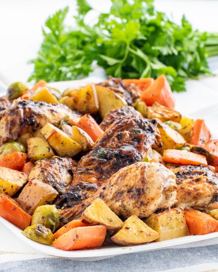 roasted chicken and vegetables on a white serving platter