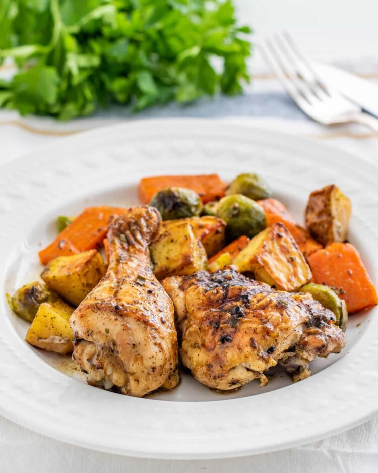 roasted chicken and vegetables on a white plate