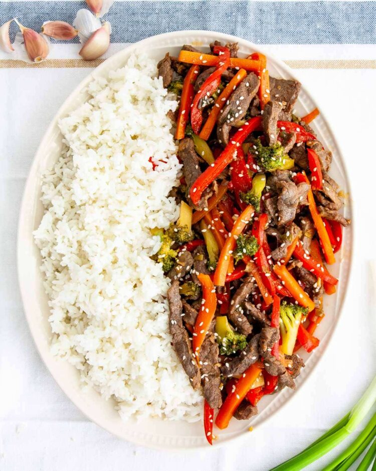 beef stir fry with rice in a big platter