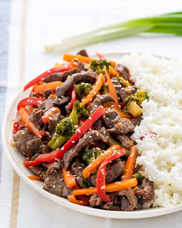 beef stir fry in platter with rice