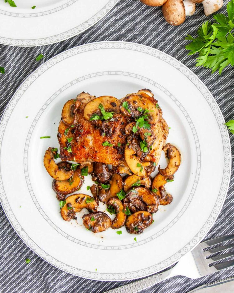 chicken and mushrooms in a white plate