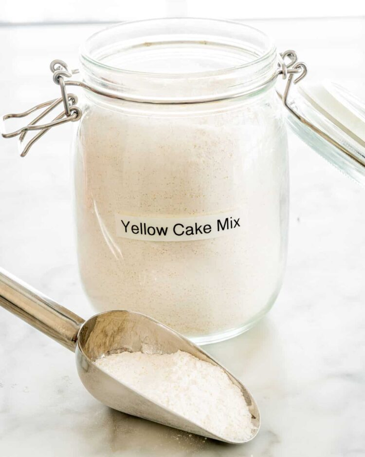 yellow cake mix in a jar with a scoop of the mix next to it