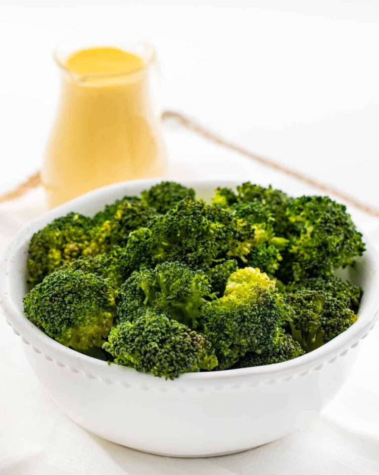 steamed broccoli in a white bowl