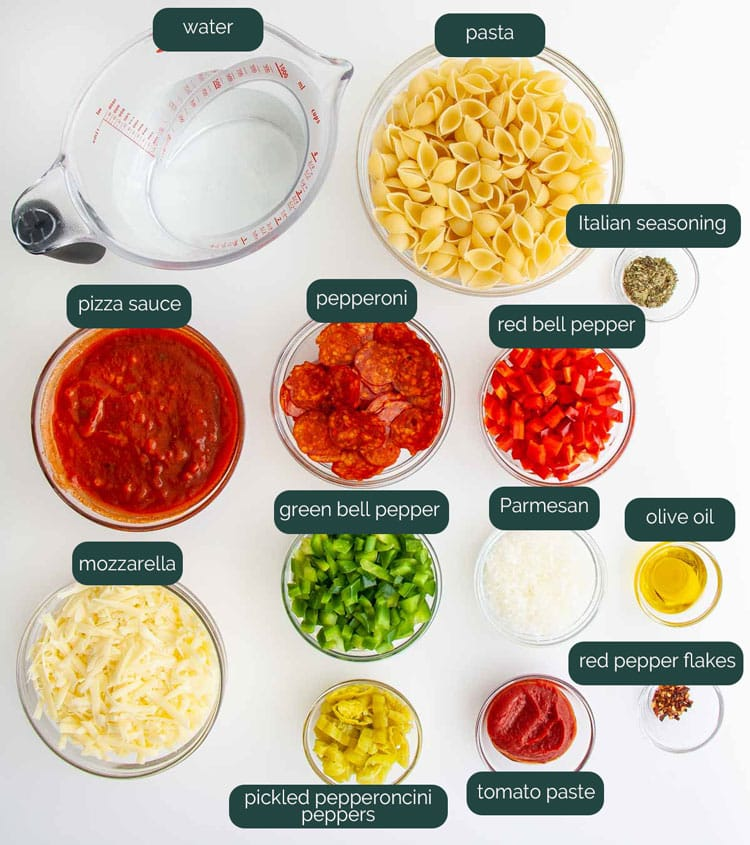 overhead shot of ingredients needed to make pepperoni pizza pasta