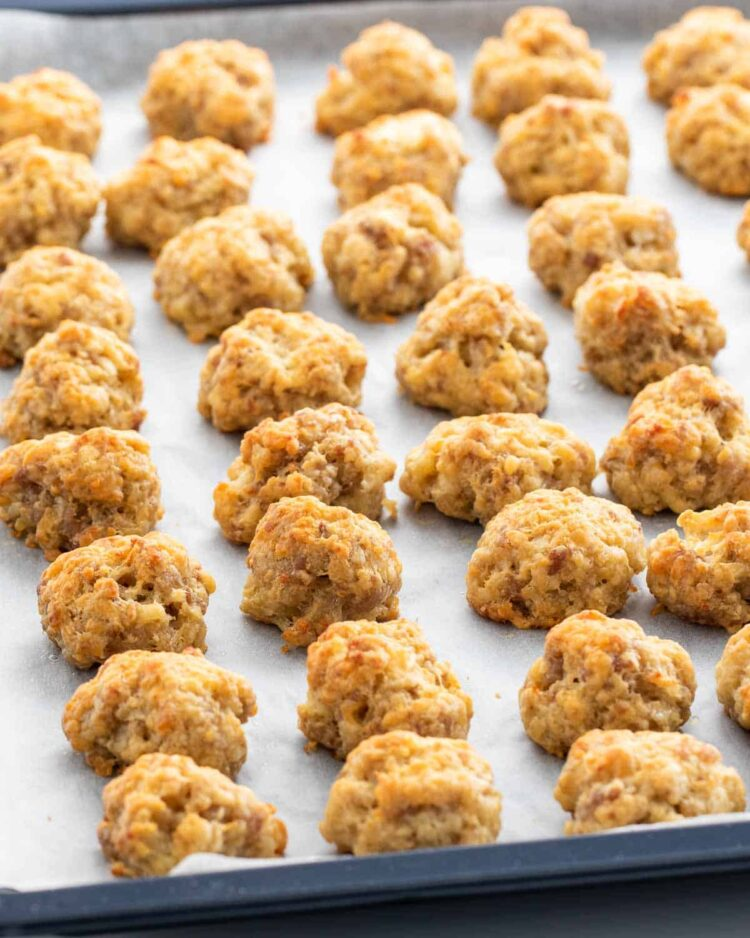sausage balls fresh out of the oven on a baking sheet