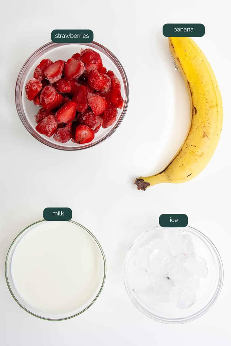 overhead shot of ingredients needed to make a strawberry banana smoothie