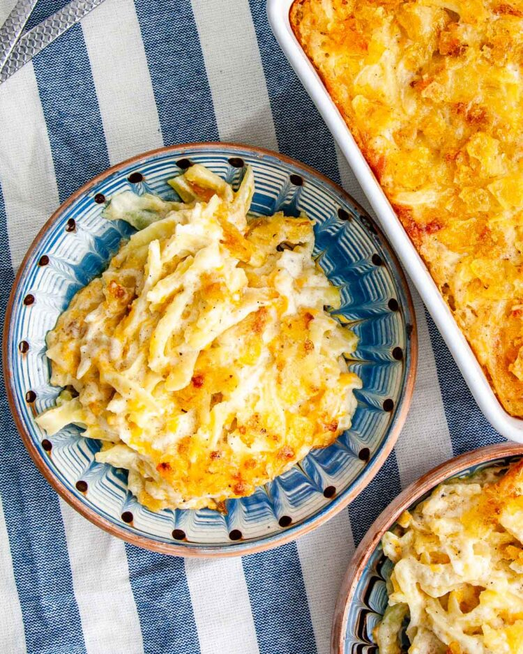overhead shot of a couple plates loaded up with cheesy potato casserole