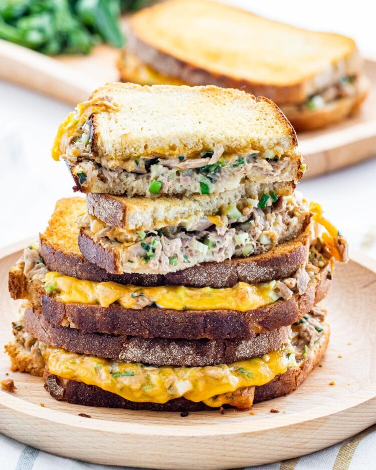 a gorgeous stack of tuna melts with the top one cut in half