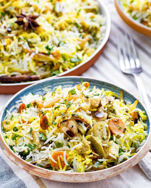 2 plates with freshly made vegetable biryani
