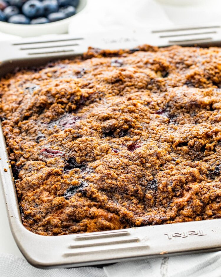 blueberry buckle in a baking pan fresh out of the oven