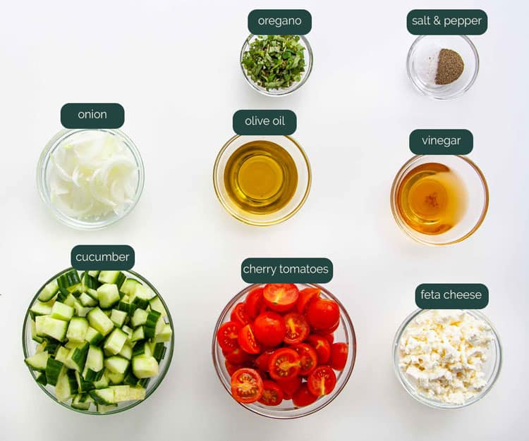 overhead shot of all the ingredients needed to make cucumber tomato salad
